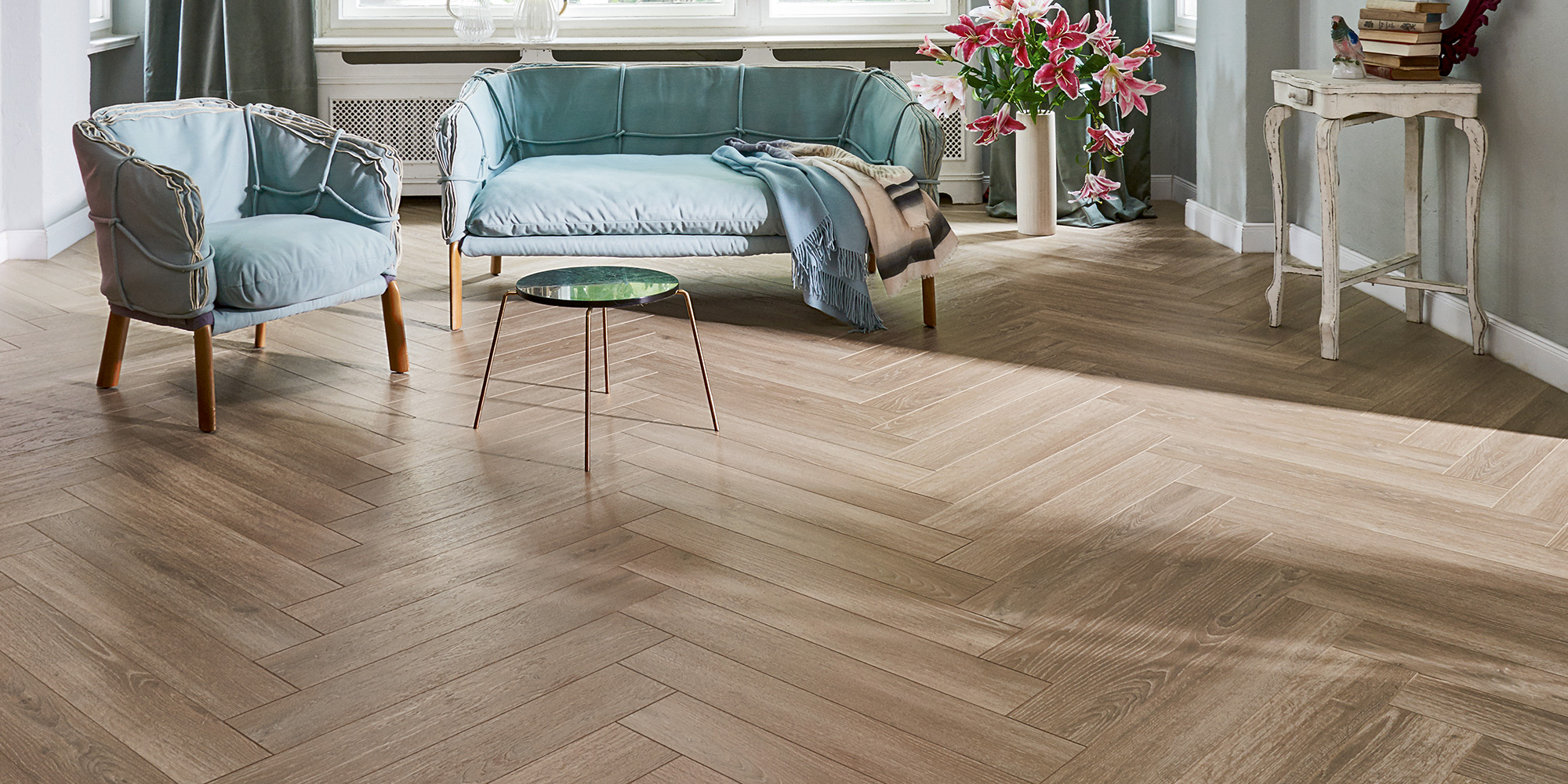 Parador Trendtime 3. 8mm herringbone laminate flooring with AC4 rating and class 32.