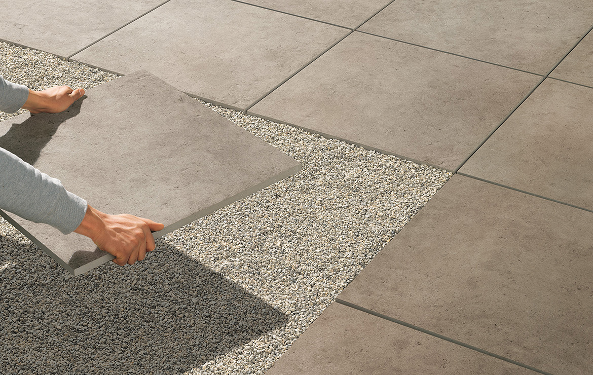Exterior paving tiles dry installation directly on the gravel or sand.