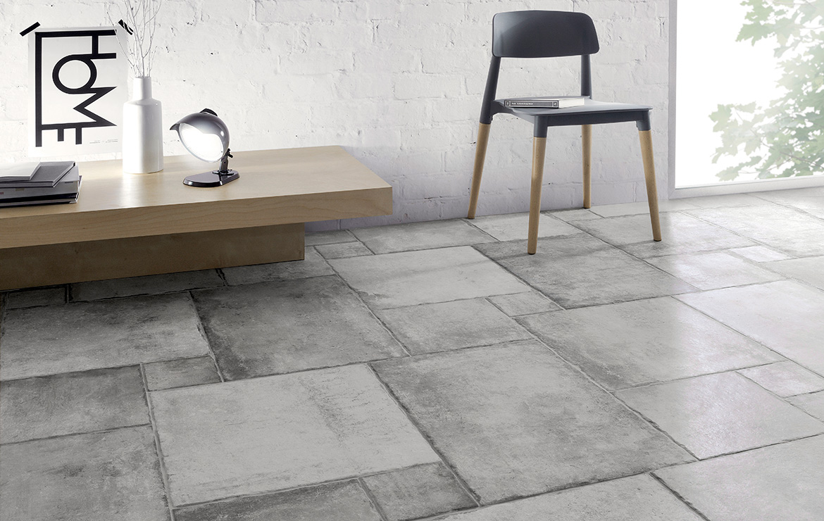 Living room with rustic concrete look modular porcelain floor tiles Heritage Grey.