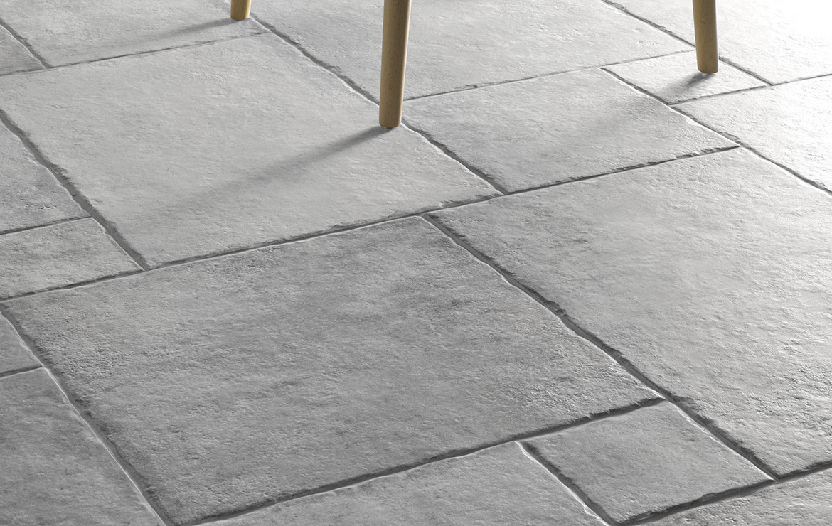 Floor design with rustic concrete look modular porcelain floor tiles Heritage Grey.