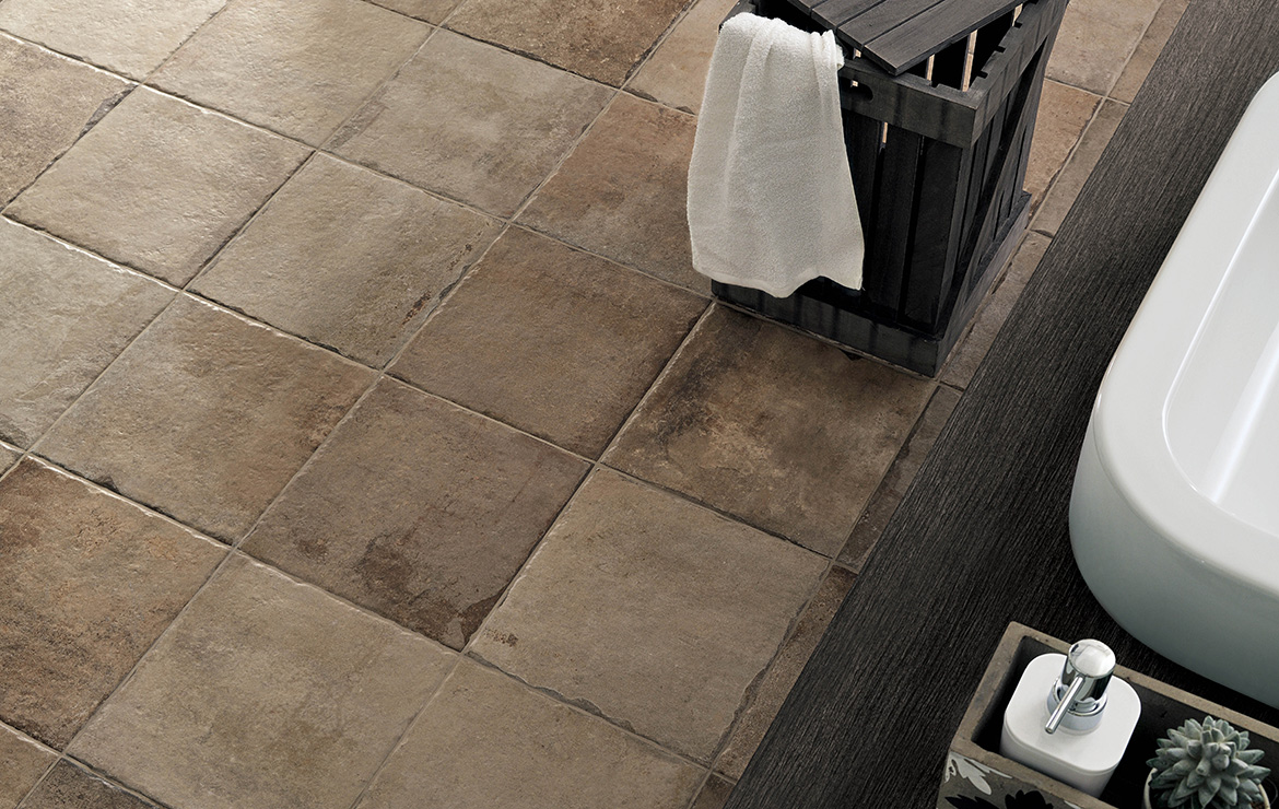 Bathroom floor design with rustic concrete look modular porcelain floor tiles Heritage Walnut.