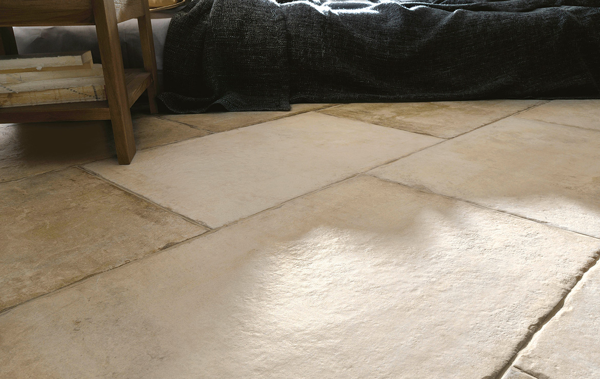Living room with rustic concrete look modular porcelain floor tiles Heritage Ivory.