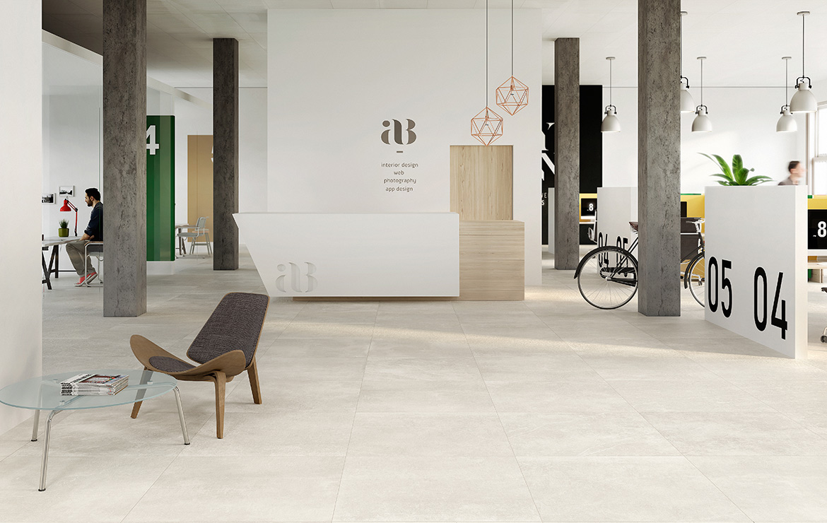 Modern style budget hotel lobby interior design with natural stone look porcelain tiles Kainos Bone 90x90.
