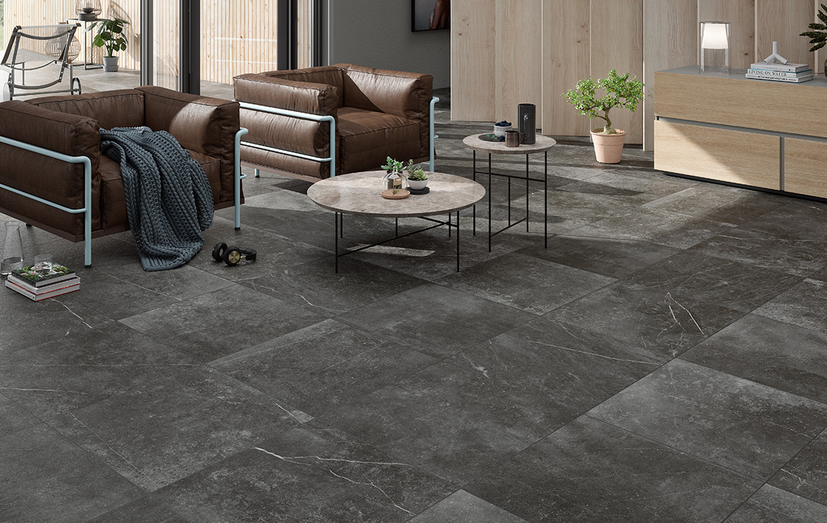Modern style living room floor design with natural stone look porcelain tiles Kainos Shadow 90x90.