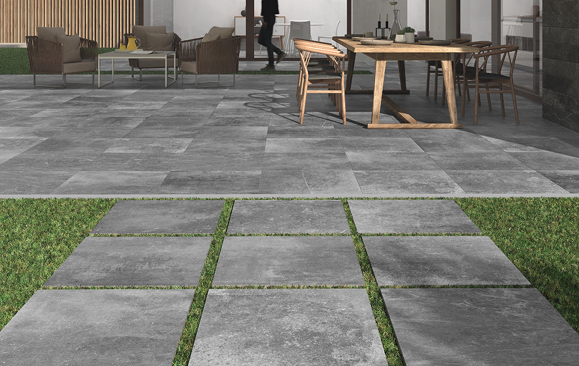 Patio floor design with natural stone look porcelain tiles Kainos Grey 90x90.
