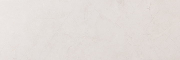 Metissage Blanco 33x100. High gloss finish, large format, stone look bathroom wall tile.