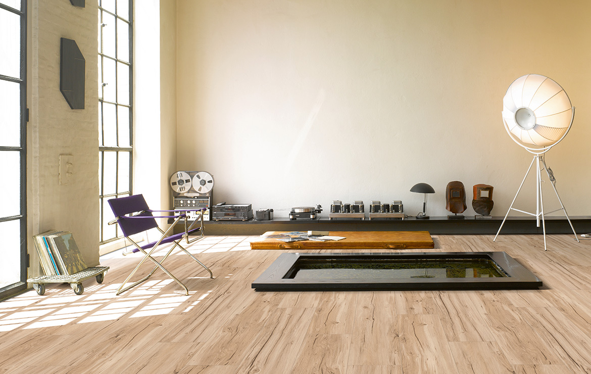 Living room interior design with wood effect vinyl flooring Parador Basic 5.3 Memory Sanded Oak 1209x225x5.3mm.