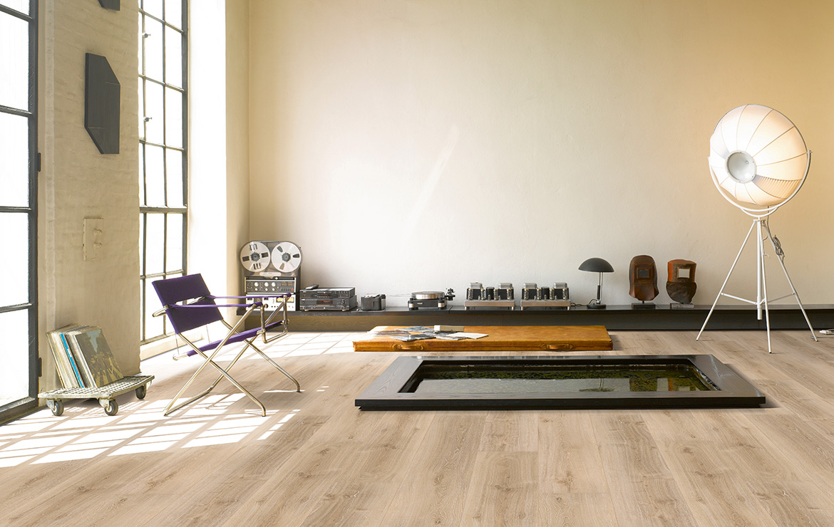 Living room interior design with wood effect vinyl flooring Parador Basic 5.3 Royal Light Limed Oak 1209x225x5.3mm.
