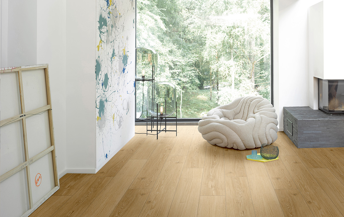 Living room interior design with 8mm laminate flooring Parador Classic 1050 Studioline Natural Oak.