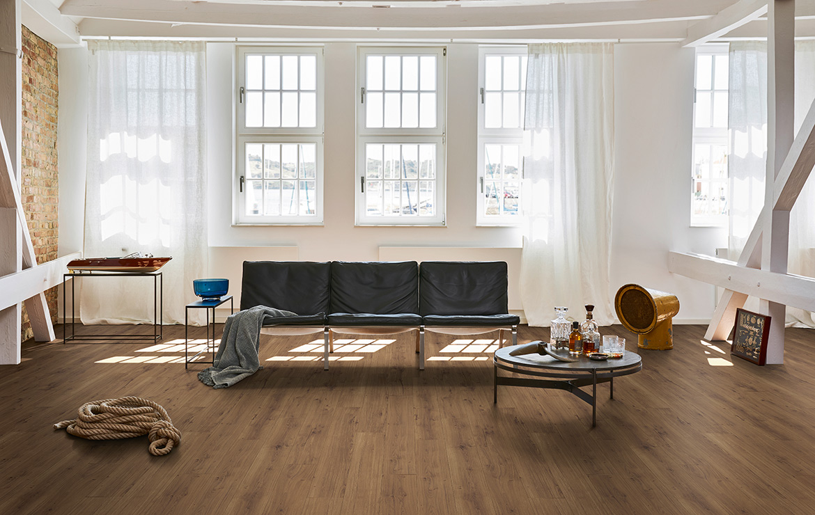 Living room interior design with resilient wood effect flooring Parador Module One Spirit Smoked Oak 2200x235x8mm.