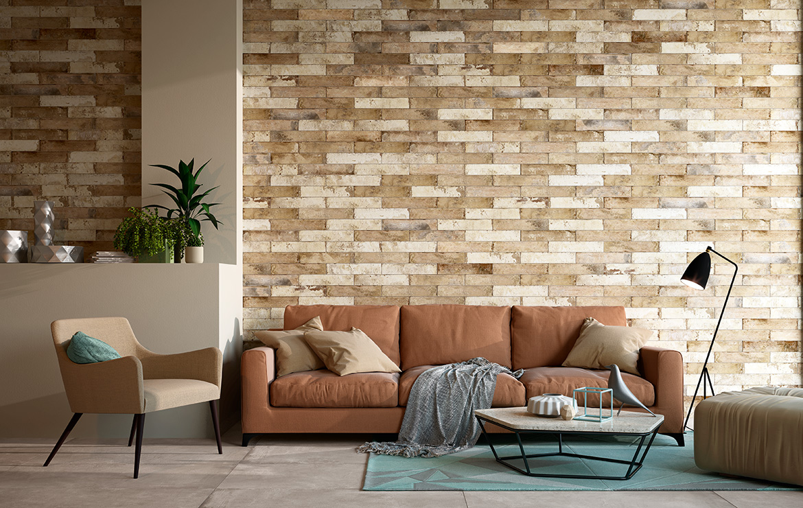 Vintage style living room wall design with brick effect tiles - Pave Brick Natural 8x41.