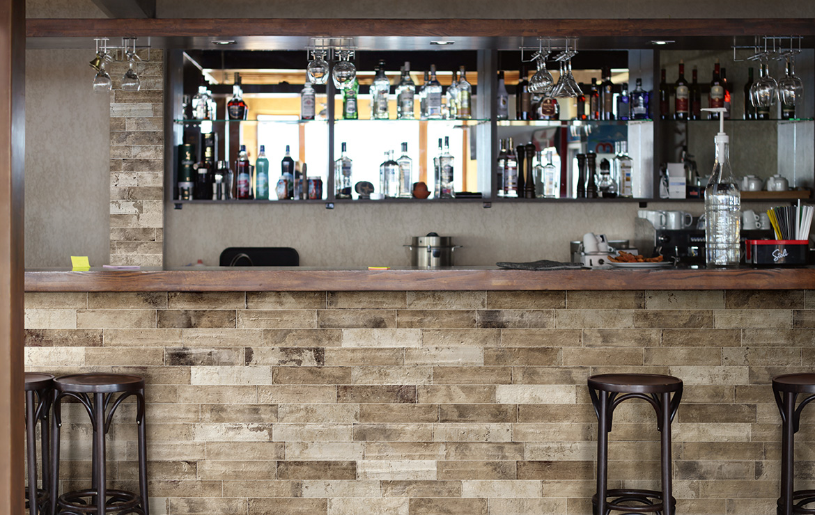 Vintage style bar wall design with brick effect tiles - Pave Brick Bruciato 8x41.