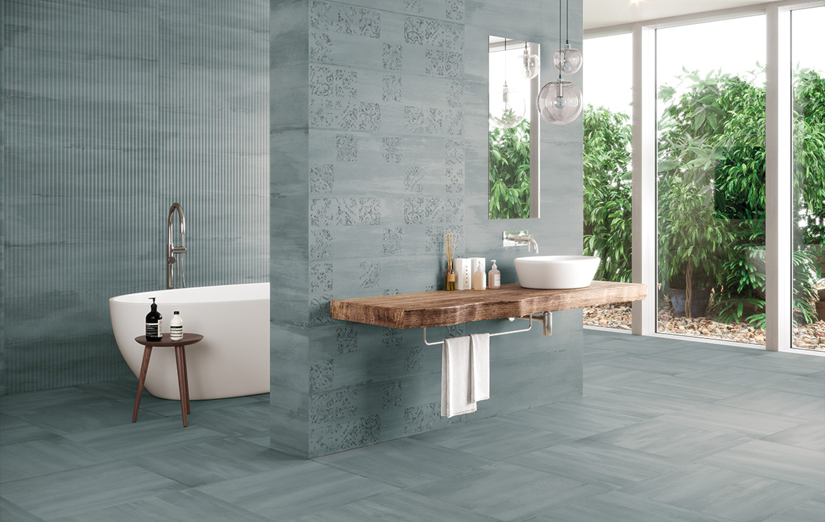 Modern style bathroom interior design with monocolour wall and floor tiles and patterned decors - Sospiro Artisan Ocean.