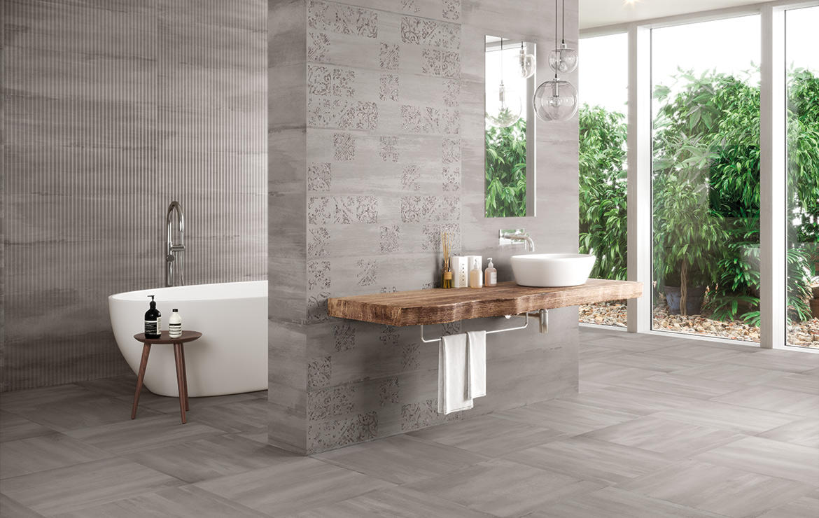 Modern style bathroom interior design with monocolour wall and floor tiles and patterned decors - Sospiro Artisan Smoke.