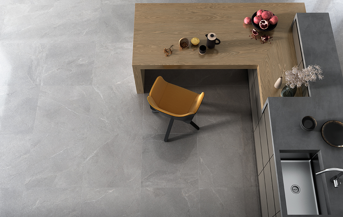 Modern style kitchen floor design with a natural stone look semi-polished porcelain tiles Terra Gris Lappato 60x60.