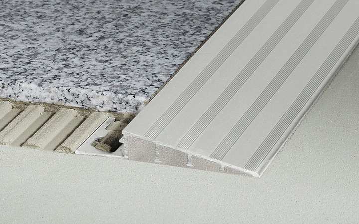 Schluter Systems in Ireland tile accessories. Reno Ramp - smooth transition between tile coverings and floor coverings at lower elevations.