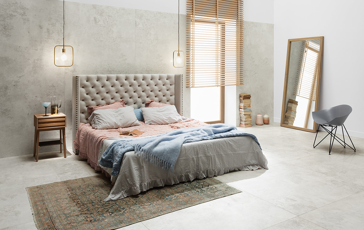 Modern style bedroom interior design with large format concrete look porcelain tiles Torano White Lappato 80x80.