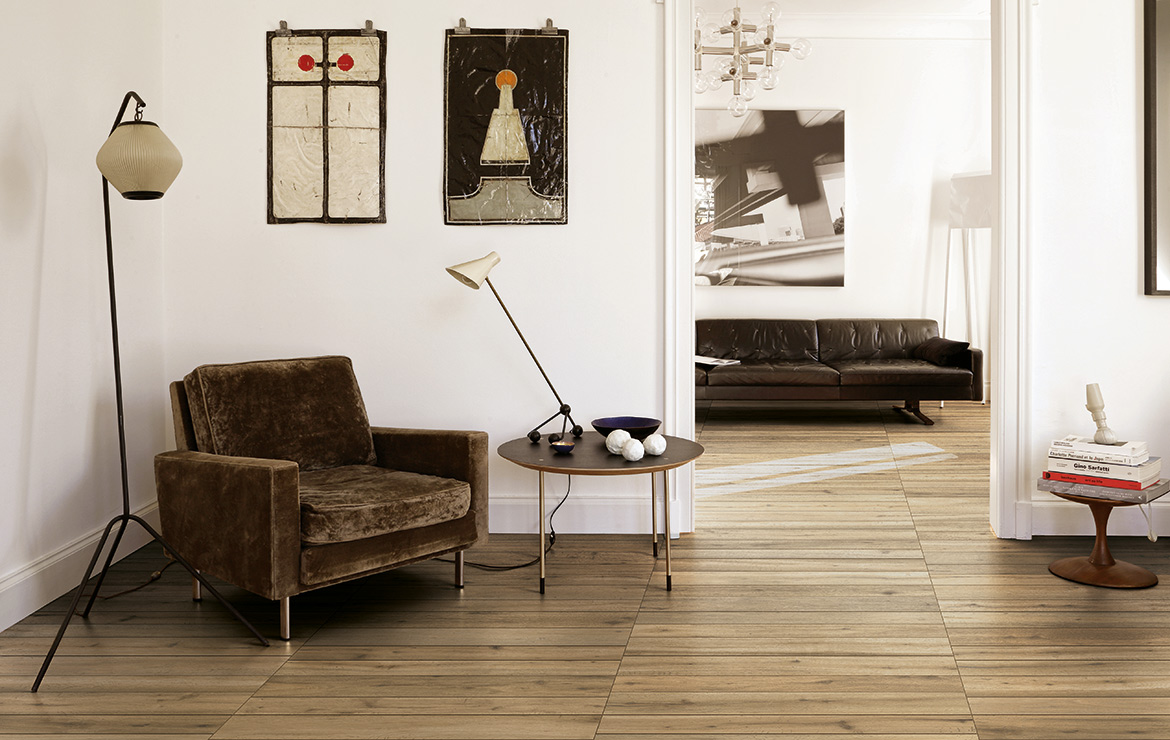 Country style bedroom interior design with wood look porcelain floor tiles Treverkmood Noce 15x90.