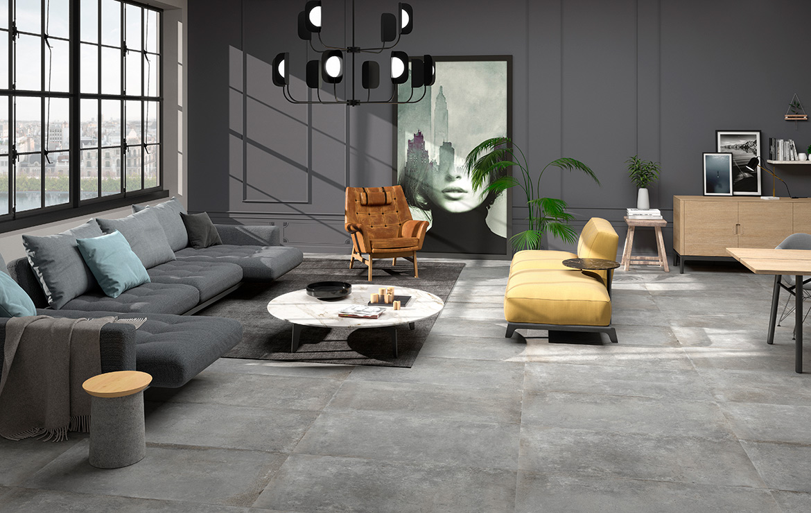 Modern style living room interior design with vintage stone look floor tiles - Universe Grey 60x60.