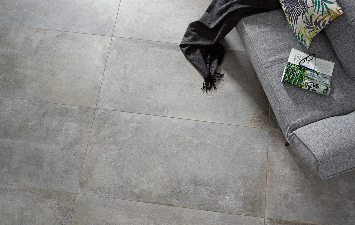Floor design detail with Universe Grey 60x60 - old stone look matt finish floor tile.