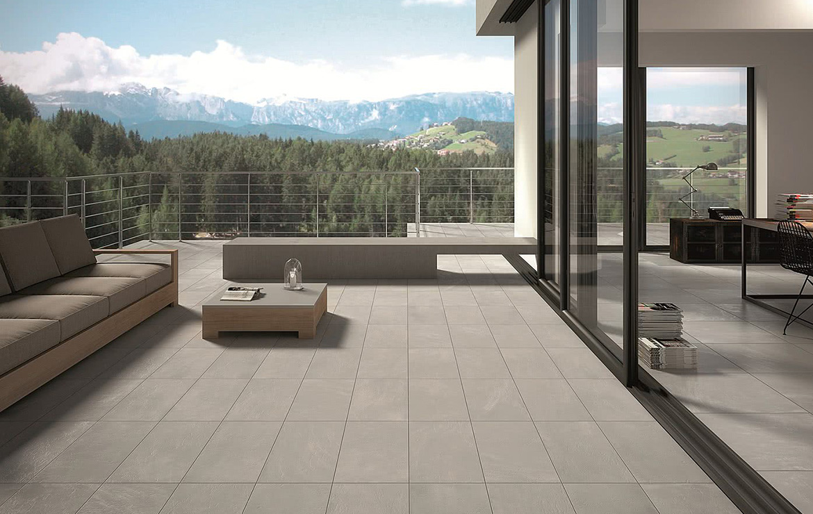 Balcony floor made with anti-slip concrete look 20mm porcelain paving tiles. Uptown Hamilton 50x100.