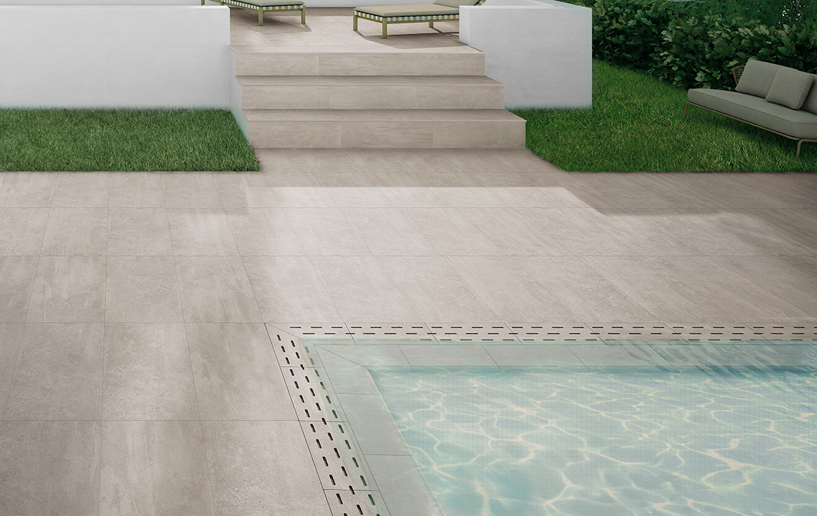 Garden patio floor made with anti-slip concrete look 20mm porcelain paving tiles. Uptown Morningside 50x100.